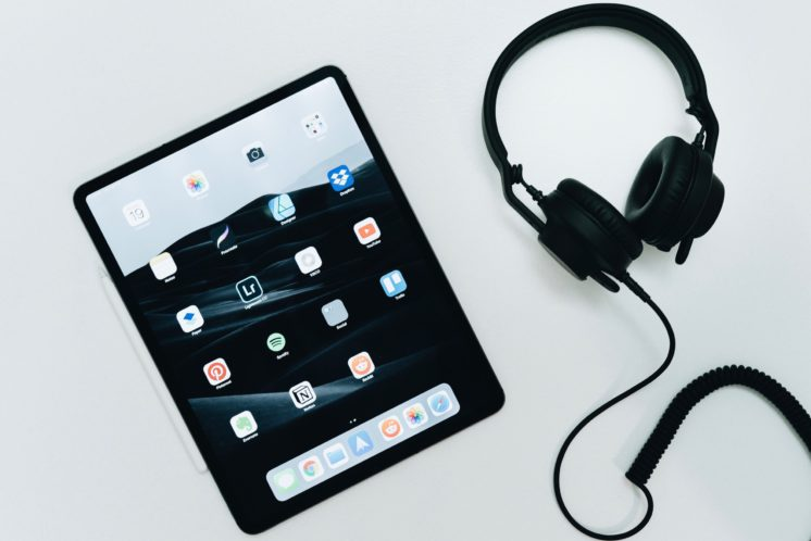 iPad and headphones on a white table
